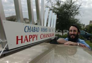 Rabbi Mendy Bukiet of Chabad of Bradenton displays a menorah on the roof of his 2003 Sonata, which will light up during Hanukkah.